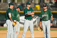 (L-R) Ryder Jones (15), Jeremy Sy (25), Brandon Bednar (19) and Ryan Tuntland (12) wait for the new pitcher to warm up during the South Atlantic League game against the Hickory Crawdads at L.P. Frans Stadium on May 11, 2014 in Hickory, North Carolina.  The GreenJackets defeated the Crawdads 9-4.  (Brian Westerholt/Four Seam Images)