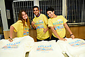 Volunteers Riley Moran, David Aspillaga and Vi Conway pose for a photo before handing out t-shirts at Tulane's Outreach Student Volunteer Day.