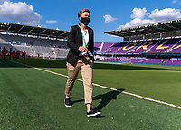 ORLANDO, FL - FEBRUARY 24: Bev Priestman of Canada walks on the field before a game between Brazil and Canada at Exploria Stadium on February 24, 2021 in Orlando, Florida.