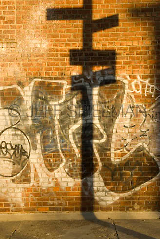Available for Commercial and Editorial Licensing Exclusively from Corbis.<br /> <br /> Please go to www.corbis.com and search for image # 42-20926996.<br /> <br /> Brick Wall covered with graffiti in late afternoon sunlight....Williamsburg, Brooklyn, New York City, New York State, USA..