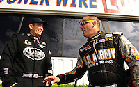 Nov. 13, 2011; Pomona, CA, USA; NHRA top fuel dragster driver Larry Dixon (left) with Tony Schumacher during the Auto Club Finals at Auto Club Raceway at Pomona. Mandatory Credit: Mark J. Rebilas-.