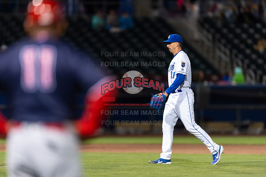 Omaha Storm Chasers relief pitcher Kyle Zimmer (31) jogs onto the field during a Pacific Coast League game against the Memphis Redbirds on April 26, 2019 at Werner Park in Omaha, Nebraska. Memphis defeated Omaha 7-3. (Zachary Lucy/Four Seam Images)