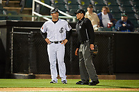 Jackson Generals manager J.R. House (22) talks with home plate umpire Brock Ballou during a game against the Chattanooga Lookouts on April 27, 2017 at The Ballpark at Jackson in Jackson, Tennessee.  Chattanooga defeated Jackson 5-4.  (Mike Janes/Four Seam Images)