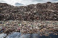 Nigeria. Enugu State. Enugu. Garbage heap. The open air and uncontrolled rubbish dump shows the failure in the solid-waste management. Enugu is the capital of Enugu State, located in southeastern Nigeria. 2.07.19 © 2019 Didier Ruef