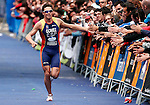 Spain's Ivan Gomez Noya congratulated by the crowd as he arrives first during World Cup Triathlon in Madrid, Sunday May 25, 2008. (ACTION IMAGES/Alvaro Hernandez)