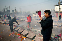 CHINA. Hubei Province. Wuhan. Burning incense in a temple. Wuhan (population 4.3 million) is a sprawling city that sits on both sides of the Yangtze River.  2008.