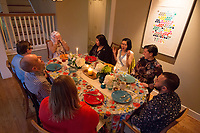 """SEATTLE, WA-APRIL 17, 2017:  (going from Amanda right and clockwise) Lots of laughter ensued during the dinner party with Amanda Saab, laughing so hard she put her hands over her face, Anjana Agarwal, Charissa Pomrehn, Patricia Rangel, Hussein Saab, Stefanie Fox, Greg Pomrehn and Nason Fox. <br /> <br /> Amanda Saab, along with her husband Hussein Saab, host a """"dinner with your Muslim neighbor"""" at the home of Stefanie and Nason (cq) Fox in Seattle, WA on a return trip April 17th 2017. The couple now live in Detroit. (Photo by Meryl Schenker/For The Washington Post)"""