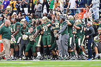Baylor players deep safety B.J. Jordan (65), wide receiver Ishmael Zamora (8)cornerback Tyler Jaynes (37) and rest of the celebrate on the sideline during an NCAA football game, Saturday, October 11, 2014 in Waco, Tex. (Mo Khursheed/TFV Media via AP Images)