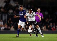 21st September 2021; Craven Cottage, Fulham, London, England; EFL Cup Football Fulham versus Leeds; Tyler Roberts of Leeds United challenges Alfie Mawson of Fulham