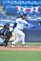 Asheville Tourists third baseman Enmanuel Valdez (2) swings at a pitch during a game against the Brooklyn Cyclones on May 7, 2021 at McCormick Field in Asheville, NC. (Tony Farlow/Four Seam Images)