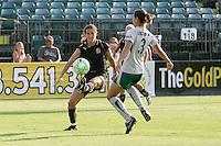 Brandi Chastain (left) kicks the ball against Stephanie Logterman (3). FC Gold Pride tied the St. Louis Athletica 1-1 at Buck Shaw Stadium in Santa Clara, California on August 9, 2009.