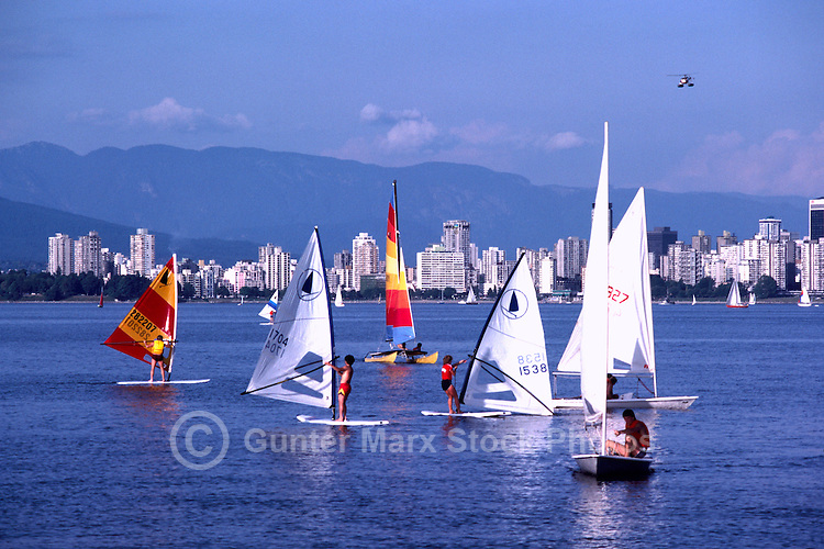 """Vancouver, BC, British Columbia, Canada - Windsurfing and Sailing in English Bay, """"West End"""" City Skyline and """"North Shore"""" Mountains (Coast Mountains) beyond"""