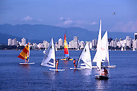 "Vancouver, BC, British Columbia, Canada - Windsurfing and Sailing in English Bay, ""West End"" City Skyline and ""North Shore"" Mountains (Coast Mountains) beyond"