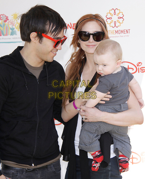 """PETE WENTZ, ASHLEE SIMPSON-WENTZ & BRONX MOWGLI WENTZ .The 20th annual """"A Time for Heroes"""" Celebrity Carnival benefiting Elizabeth Glaser Pediatric AIDS Foundation held at Wadsworth Theater on the Veteran Administration Lawn in West Los Angeles, California, USA. .June 7th, 2009.half length grey gray top black profile  sunglasses shades lifting carrying mother mom mum daughter son boots married husband wife father dad.CAP/DVS                                                  .©Debbie VanStory/Capital Pictures."""
