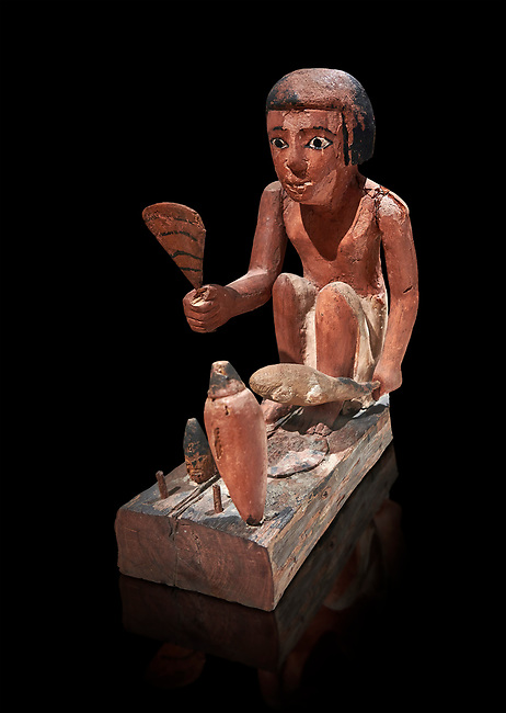 Ancient Egyptian wooden model of a man cooking a duck, New Kingdom, 11-13th Dynasty, (1980-1700 BC), Asyut. Egyptian Museum, Turin. Cat 8944. black background. <br /> <br /> Wooden tomb models were an Egyptian funerary custom throughout the Middle Kingdom in which wooden figurines and sets were constructed to be placed in the tombs of Egyptian royalty. These wooden models represented the work of servants, farmers, other skilled craftsman, armies, and religious rituals