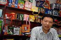 Mr Liu of the Richall factory that makes woven plastic bags can be used many times and are seen as environmentally friendly. The comapny makes plastic bags for several clients including Disney and Sainsbury's.<br /> <br /> Photo by Richard Jones / Sinopix