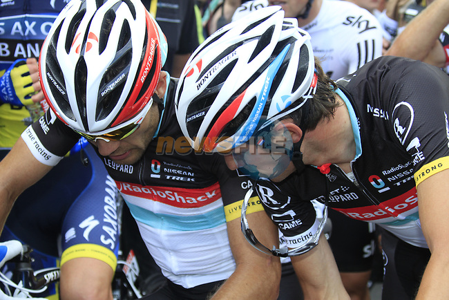 Frank Schleck (LUX) talks to Radioshack-Nissan team mate Maxime Monfort (BEL) at the end of Stage 1 of the 99th edition of the Tour de France, running 198km from Liege to Seraing, Belgium. 1st July 2012.<br /> (Photo by Eoin Clarke/NEWSFILE)