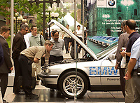 June 10 2002, Montreal, Quebec, Canada; <br /> <br /> Pedestrians take a moment to look at a<br />  BMW liquid hydrogen-fueled vehicle, series 750 HL<br /> displayed near the Fairmount-Queen Elizabeth Hotel in Montreal, Canada<br /> where the 14th World Hydrogen Energy Conference is beeing held, June 10 to 12, 2002<br /> <br /> <br /> <br /> NOTE :  D-1 H original JPEG, saved as Adobe 1998 RGB