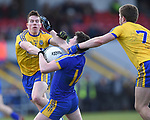 Keelan Sexton of Clare in action against Sean Mc Dermott and Niall Daly of Roscommon during their National League game at Cusack Park. Photograph by John Kelly.