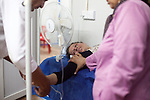 DOMIZ, IRAQ: A nurse from the NGO Doctors Without Borders treats a Syrian refugee who fainted...Over 7,000 Syrian Kurds have fled the violence in Syria and are living in the Domiz refugee camp in the semi-autonomous region of Iraqi Kurdistan...Photo by Ali Arkady/Metrography