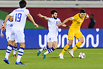Jaloliddin Masharipov of Uzbekistan (C) fights for the ball with Tom Rogic of Australia (R) during the AFC Asian Cup UAE 2019 Round of 16 match between Australia (AUS) and Uzbekistan (UZB) at Khalifa Bin Zayed Stadium on 21 January 2019 in Al Ain, United Arab Emirates. Photo by Marcio Rodrigo Machado / Power Sport Images