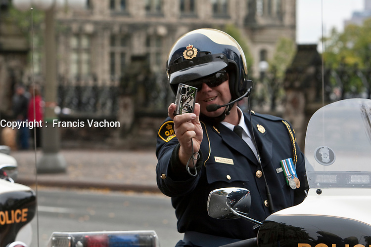 OPP Ontario Provincial Police motorcycle is seen during a police memorial parade in Ottawa Sunday September 26, 2010.
