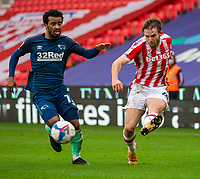 20th March 2021; Bet365 Stadium, Stoke, Staffordshire, England; English Football League Championship Football, Stoke City versus Derby County; Rhys Norringrton-Davies of Stoke City crosses the ball in front of Nathan Byrne of Derby County