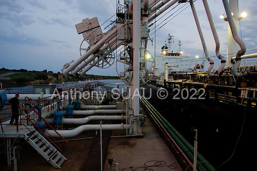 Yuzhniy, Odessa region, Ukraine.August 24, 2005 ..The Odessa-Brody pipeline port station, Marine Oil Terminal ?Pivdennyy?, loads ninety thousand tons of oil on to a ship heading to Turkey. This is where Caspian oil is planned to transit into Europe. Currently the oil is flowing in the opposite direction through the pipeline from Russia-Brody-Odessa then by ship to Europe...The Ukrainian pipeline is waiting for European clients to modify their refineries to accept Caspian oil as it is different from Russian oil. The line will make Ukraine far less dependent on Russian for oil and Russia sees it as a line that will break its' monopoly on oil to Europe. The oil is planned travel from Kazakhstan, Azerbaijan, Georgia and then by ship to Odessa and then by this pipeline into Europe.........