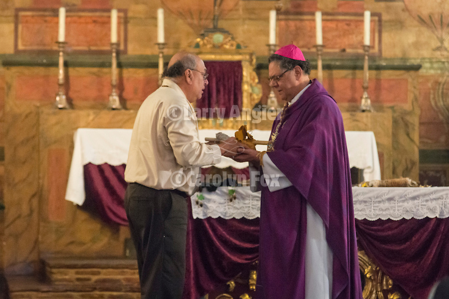 """Bishop Garcia accepts a gift from Valentin Lopez during the historic Mass of Reconciliation, Mission San Juan Bautista, California...Lead by His Grace, Bishop Richard Garcia of the Monterey Diocese and Amah Mutsun Band of Costanoan/Ohlone Indians Chairperson Valentin Lopez within the chapel...Founded on June 24, 1797 by Franciscan Padre Fermín Lasuén, San Juan Bautista is the 15th established and the largest of the 21 missions in California. ..Known as """"The Mission of Music"""", it is the only mission that has served mass daily since its founding."""