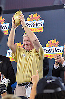 January 01, 2014:<br /> <br /> University of Central Florida Head Coach George O'Leary raises Tostitos Fiesta Bowl trophy at University of Phoenix Stadium in Scottsdale, AZ. UCF defeat Baylor 52-42 to claim it's first ever BCS Bowl trophy.