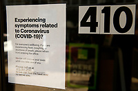 A sign hangs on the door of H&R Block on Smithfield Street in downtown on Sunday March 15, 2020 in Pittsburgh, Pennsylvania. (Photo by Jared Wickerham/Pittsburgh City Paper)