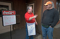 Michael Evans, left, laughs with Mike Purdum as they stand near the doorway of Evans' pizza restaurant Friday, January 13, 2006, on the first day of alcohol sales in downtown Westerville, Ohio. A ballot issue in the November 2005 election approved alcohol sales in downtown Westerville, home to the Anti-Saloon League. Michael's Pizza is one of several new alcohol sales permits in the city. Purdum is opening a bar and restaurant in a refurbished building at the center of town, just a block from Evan's shop. Alcohol was last served in the city more than 120 years ago.<br />