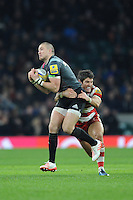 Mike Brown of Harlequins is tackled by James Hook of Gloucester Rugby during the Aviva Premiership Rugby match between Harlequins and Gloucester Rugby at Twickenham Stadium on Tuesday 27th December 2016 (Photo by Rob Munro/Stewart Communications)