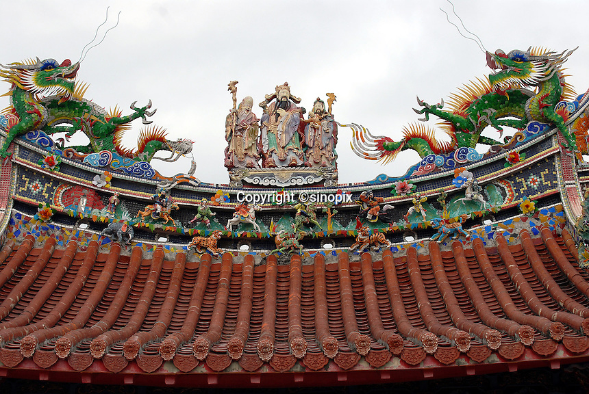 Ornately decorated temple rooftop, just north of Taitung City, Taiwan. Taitung, and the coastal strip north of it up to Chenggong, has been seeing a big increase in property investment and new construction as people from the capital, Taipei, and some foreign investors, seek to buy holiday and retirement homes in this area of outstanding natural beauty.  At the same time, property prices across the board in Taiwan are expected to rise bullishly following a return of the former ruling party - the KMT - to power in March 2008 elections, and their anticipated change of policy to allow Mainland Chinese purchases of Taiwan property. .20 Jan 2008