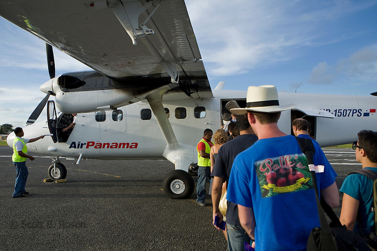"Tourists and locals board an Air Panama flight back to Panama City at Bocas del Toro ""Isla Colon"" International Airport, Panama"