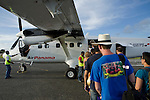 "Tourists and locals board an Air Panama flight back to Panama City at Bocas del Toro ""Isla Colon"" International Airport, Panama"