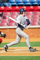 Rand Ravnaas #33 of the Georgetown Hoyas follows through on his swing against the Delaware State Hornets at Gene Hooks Field on February 26, 2011 in Winston-Salem, North Carolina.  Photo by Brian Westerholt / Four Seam Images
