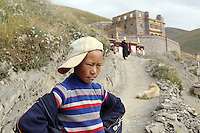 Pilgrims in the town of Sershul on the Tibetan Plateau, in western China. The town is home to a large monastery which houses thousands of monks. The Sanjiangyuan or Three Rivers Headwater region of western China contains the sources of the Yangtze, Mekong and Yellow Rivers.