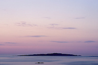 Dawn from Vasskalven Island.  I watched this sliver of land slowly emerge from the predawn darkness as the sky and water turned shades of pink and purple.