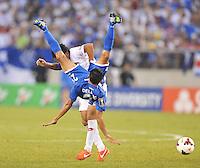 Edder Delgado (23) of Honduras gets fouled.  Honduras defeated Costa Rica 1-0 at the quaterfinal game of the Concacaf Gold Cup, M&T Stadium, Sunday July 21 , 2013.