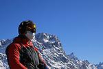 FIS Alpine World Ski Championships 2021 Cortina . Cortina d'Ampezzo, Italy on February 17, 2021. Alpine Team Event, a man wearing a mask due to Coronavirus Outbreak looks up.