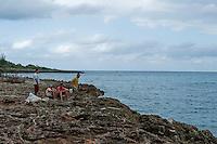 Rural scene Holguin Province, Cuba. 9-12-10 Local fishermen by the coast.