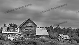 """Originally titled """"Weathered Old Farm,"""" when a friend was looking at this picture, he muttered, """"Home Sweet Home.""""  It was taken somewhere west and south of Yellowstone National Park."""