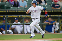 Round Rock Express third baseman Alex Buchholz (5) sprints to home plate against the Oklahoma City RedHawks during the Pacific Coast League baseball game on August 25, 2013 at the Dell Diamond in Round Rock, Texas. Round Rock defeated Oklahoma City 9-2. (Andrew Woolley/Four Seam Images)