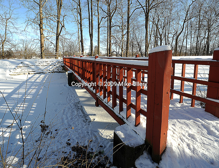 Staff Photo/Mike Ullery, Piqua Daily Call..The foot bridge over the hydraulic canal at Upper Fountain Park got very little traffic on Friday as sub-zero temperatures forced most to spend the day indoors.