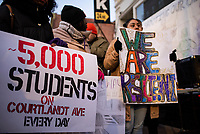 NEW YORK, NY - DECEMBER 11: Kids hold placards as as they take part during a protest on  December 11,2019 in the Bronx New York City. Residents demand safe streets in response to the escalating violence between gangs, wounded five people, including a 10 and 14-year-old on this area nearly 4,000 students  attend school, daycare, and after-school programs in the 3-block radius of where this violence occurred.<br /> (Photo by Joana Toro/VIEWPress/Corbis via Getty Images)
