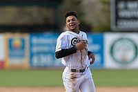 Kane County Cougars Jorge Perez (16) celebrates a victory after a Midwest League game against the Cedar Rapids Kernels at Northwestern Medicine Field on April 28, 2019 in Geneva, Illinois. Kane County defeated Cedar Rapids 3-2 in game one of a doubleheader. (Zachary Lucy/Four Seam Images)