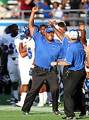Armwood Hawks coaches celebrate the clinching play during the fourth quarter of the Florida High School Athletic Association 6A Championship Game at Florida's Citrus Bowl on December 17, 2011 in Orlando, Florida.  Armwood defeated Miami Central 40-31.  (Photo By Mike Janes Photography)