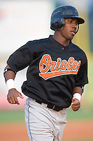 Arthur Bonevacia (25) of the Bluefield Orioles rounds third base to score a run at Burlington Athletic Park in Burlington, NC, Saturday, July 26, 2008. (Photo by Brian Westerholt / Four Seam Images)