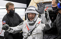 Japan Aerospace Exploration Agency (JAXA) astronaut Soichi Noguchi is helped out of the SpaceX Crew Dragon Resilience spacecraft onboard the SpaceX GO Navigator recovery ship after he, NASA astronauts Mike Hopkins, Shannon Walker, and Victor Glover, landed in the Gulf of Mexico off the coast of Panama City, Florida, Sunday, May 2, 2021. NASA's SpaceX Crew-1 mission was the first crew rotation flight of the SpaceX Crew Dragon spacecraft and Falcon 9 rocket with astronauts to the International Space Station as part of the agency's Commercial Crew Program. <br /> Mandatory Credit: Bill Ingalls / NASA via CNP / MediaPunch